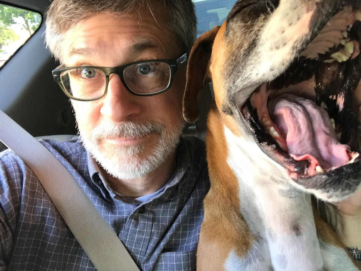 Mark Murdock with his Dog in the car seat